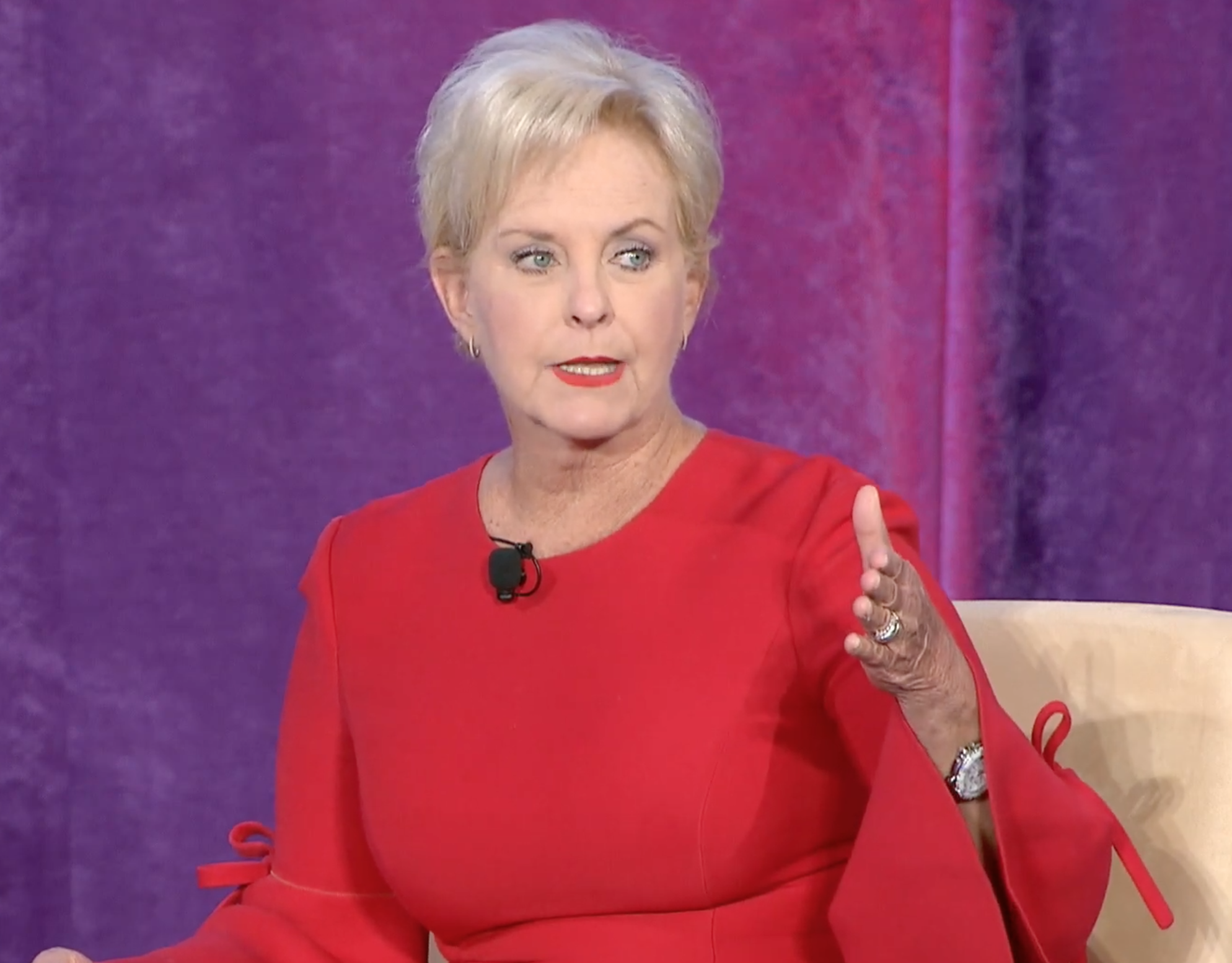 Photo of Cindy McCain seated.