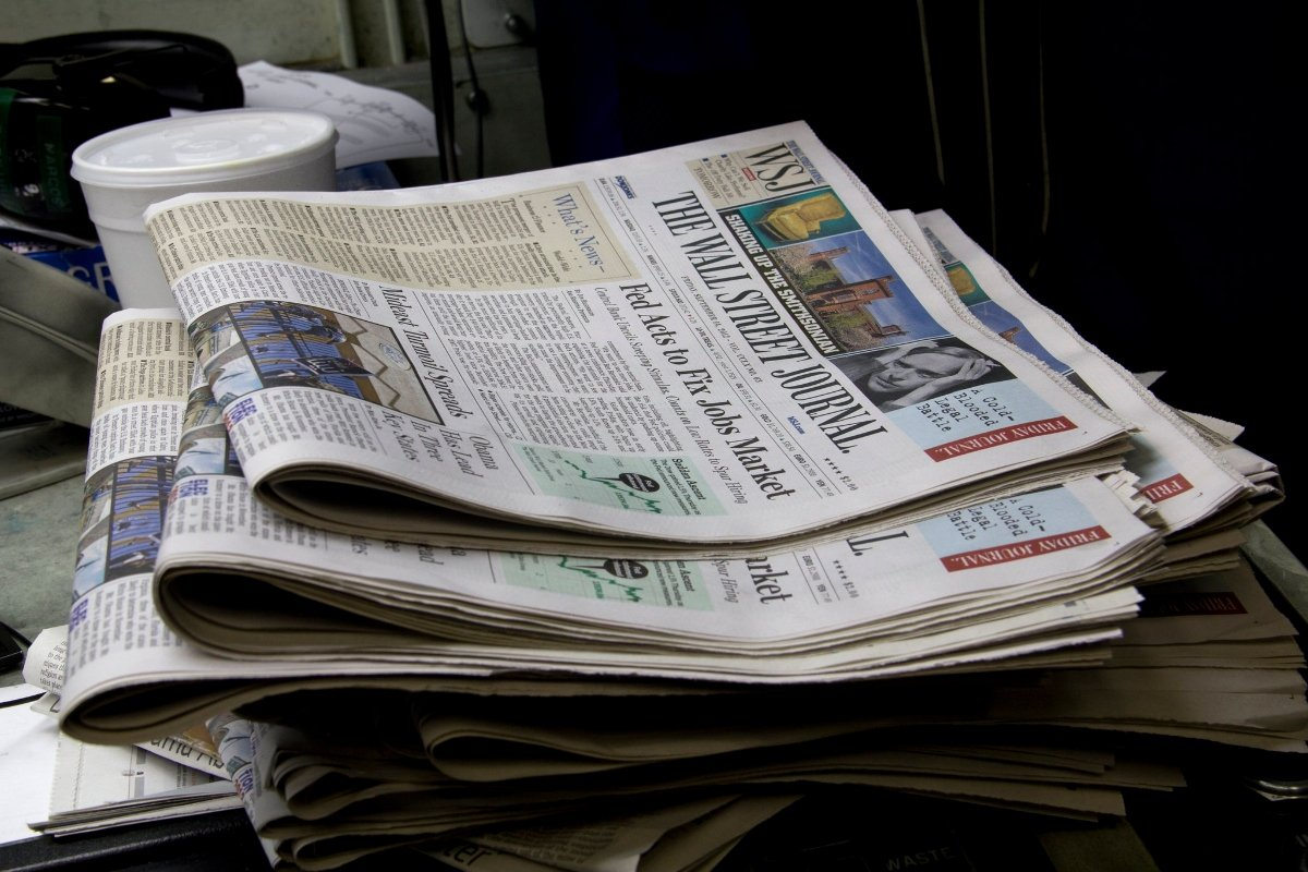 Photo of a stack of Wall Street Journals.
